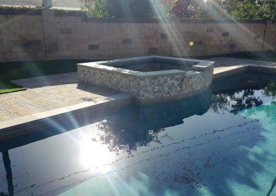 Genesis Stoneworks pool deck Belgard pavers Avalon slate victorian