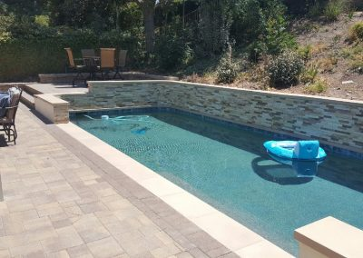 Genesis Stoneworks pool deck Angelus pavers courtyard